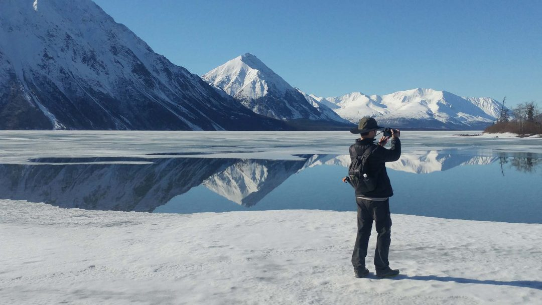 Ice-Fishing with Yukon Guided Adventures on glacier fed frozen lakes